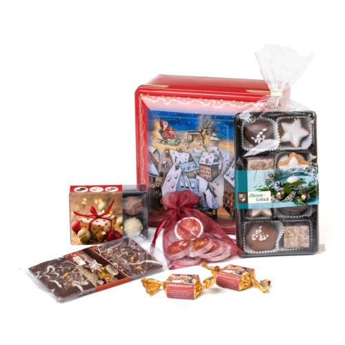 Süße Präsentdose mit weihnachtlichem Motiv und schokoladigem Inhalt