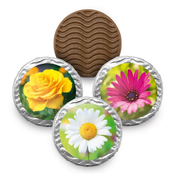 Vollmilchtaler aus zarter Schokolade mit 3 Blumenmotiven