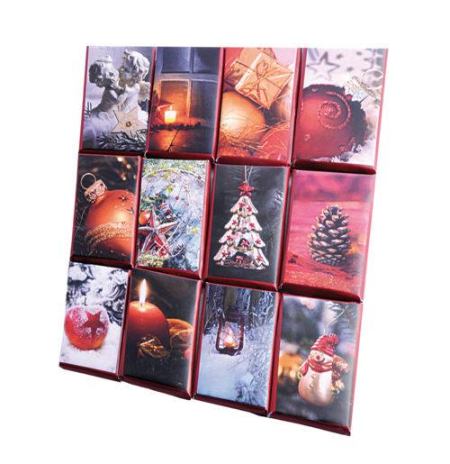 Klarsichtbox mit 24 weihnachtlichen Vollmilch-Täfelchen